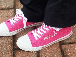 BANGOR, MAINE -- 09/18/2016 -- Breast Cancer surviver Linda Bean of Corinth sported some snazzy sneakers during this year's Susan G. Komen Race for the Cure event in Bangor on Sunday. The shoes were customized for her by her daughter, Melissa Jones of Corinth, who also is a survivor of the disease.